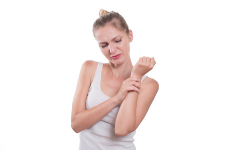 carpal tunnel: Wrist pain. Woman holding her wrist, isolated on white background