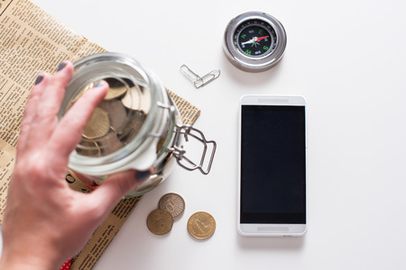 body parts cell phone: Jar of coins. Saving concept