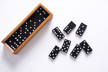 Dominoes on white surface Stock Photo