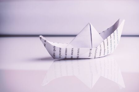 Paper boat sails, on white background Stock Photo