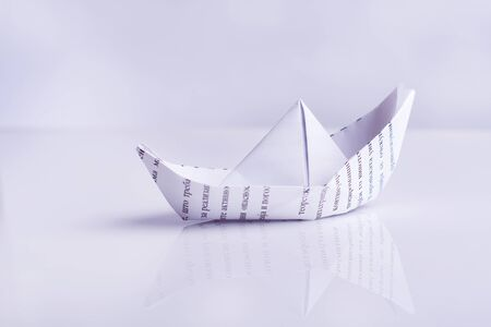 paper boat: Paper boat sails, on white background Stock Photo