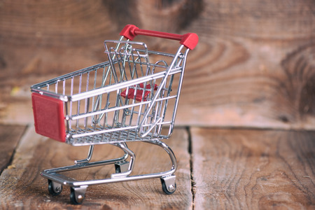 Shopping Cart on wooden background