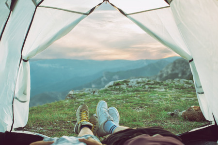 Young couple camping on mountain