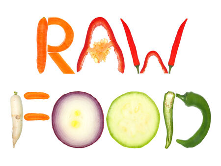 written text: Raw Food written with letters formed from vegetables