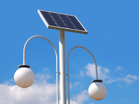 Street lighting pole with photovoltaic panel photo