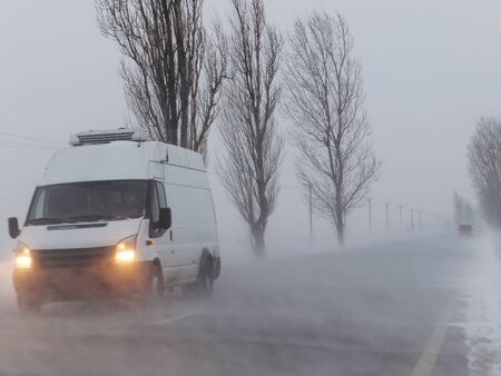 Road under the blizzard, snowstorm in winter