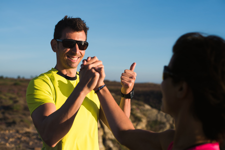 Fitness sport running couple celebrating cheerful and happy giving high five and thumbs up Banco de Imagens