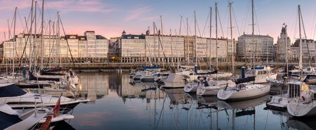 Panoramic view of touristic sea sport harbor with modernist architecture buildings at down in A Coruña, Galicia, Spain. Relaxing leisure touristic popular must see destination place in Corunna. Banco de Imagens - 69299596