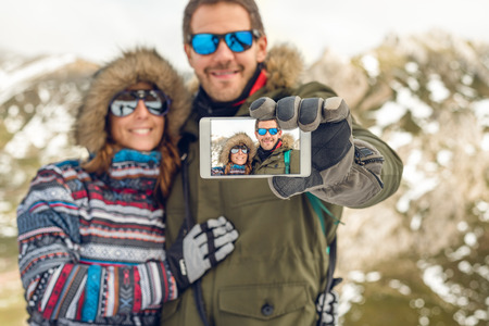 Young hiker couple trekking taking selfie