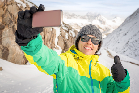 Active healthy smiling woman tanking selfie