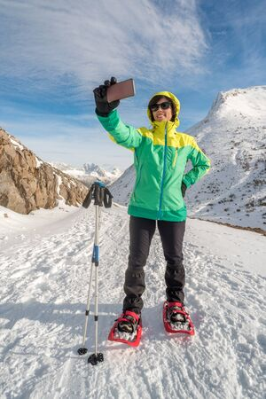Active healthy smiling woman taking selfie