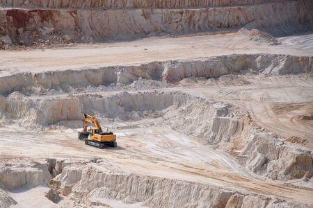 kaolin: Heavy industrial equipment in open mine kaolinite quarry