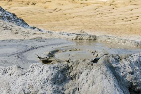 Landscape of mud volcano in Berca, Romania on sunny day. Standard-Bild