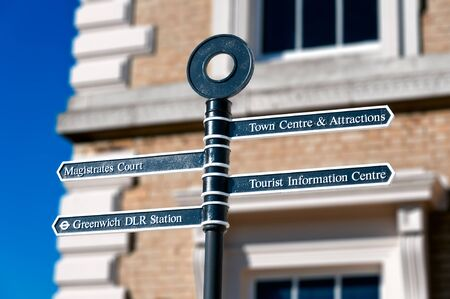 magistrates: Metalic signpost with four signs to different destinations in London