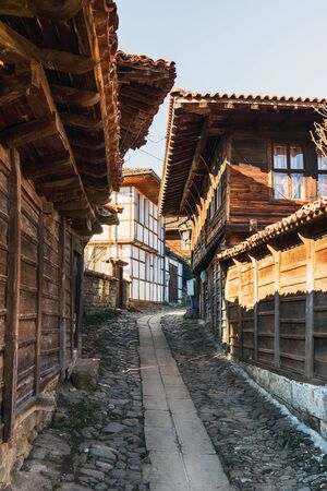 Narrow street and traditional houses in Kotel, Bulgaria