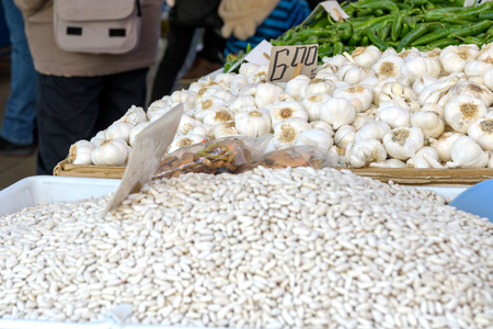 Garlic and white beans at market stall