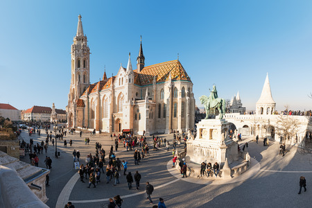 Budapest, Hungary - December 30, 2016: King St Stephen equestrian Statue by sculptor Alajas Strobl and Matthias church (Matyas templom) at Fisherman Bastion, Castle Hill (Varhegy), Buda, Budapest