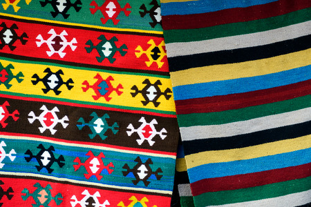 Bulgarian hand-made carpets with different ethnic ornaments