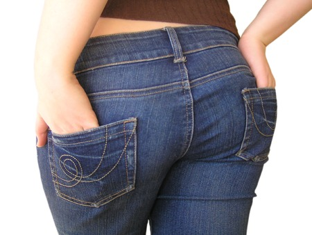 rude: A cheeky shot of the behind of a girl in jeans. Isolated on a white background.