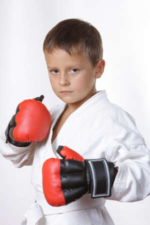 a boy in a kimono and red gloves Stock Photo