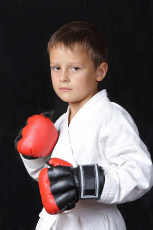 boy with boxing gloves on a black background