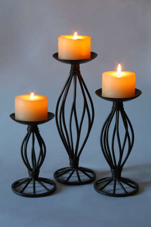 lighted candles on a gray background