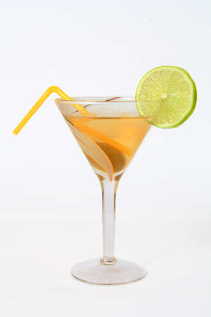 a glass of cocktail with lemon on a white background