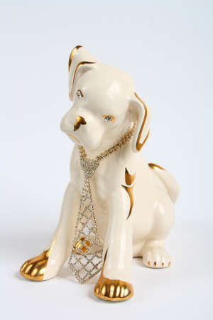 Statuette of a puppy with the jewelry on a white background