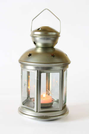 Decorative lantern with a candle on a white background