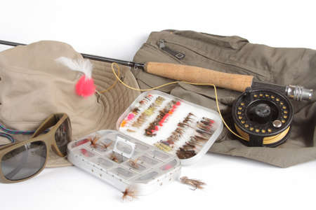Fishing rod and reel, hat, a box of flies, glasses, jacket on a white background