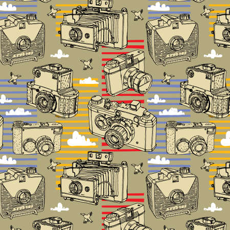 'catch the moment': Seamless pattern with retro cameras on the background font.