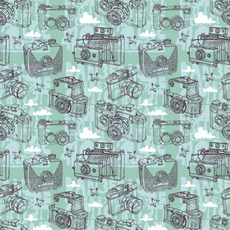 'catch the moment': Seamless pattern with retro cameras on the background sky, clouds and birds.