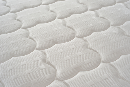 Background of soft comfortable quilted white mattress
