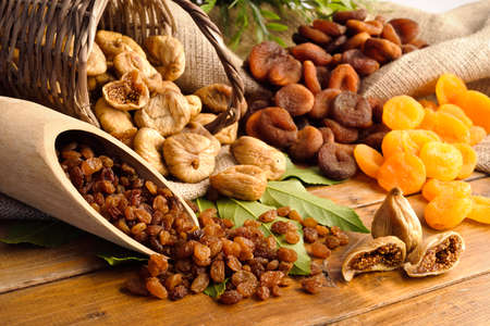 raisins , dried figs, dried apricots photo