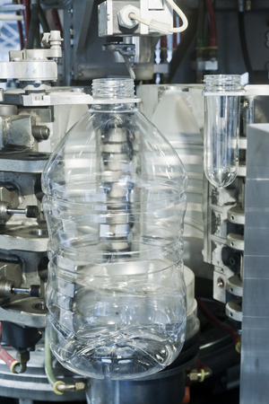 Basket with PET (PolyEthylene Terephthalate) preforms for bottles. Stock Photo