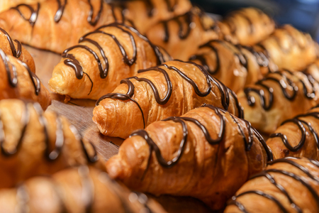 Fresh hot croissants just out of the oven, the heatlamps are still glowing photo