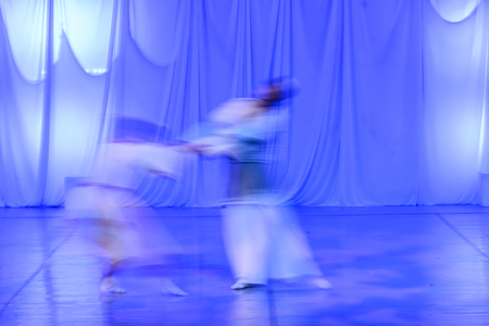 whirling: Whirling Dervishes in white and in a religious trance performing on a Turkish stage.