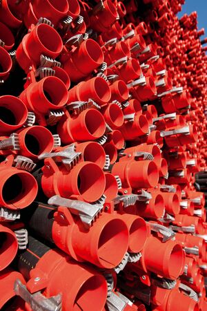 personal point of view: Bunches of PVC pipe sitting on palets at a wholesale pipe store.