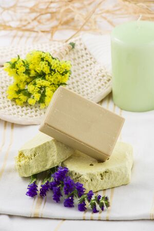 soap sud: Piece of natural soap with herbs and flowers.