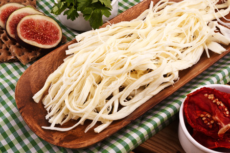 String Cheese On Chopping Board