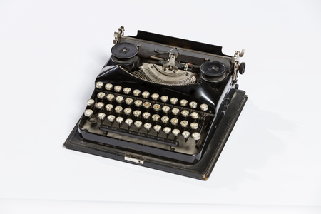 correspond: Old fashioned, vintage typewriter isolated on white background with a blank sheet of paper inserted with space for a custom message