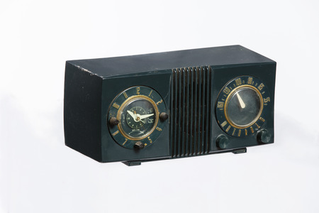 bakelite: An old retro-style radio from the 1950s isolated on white background.