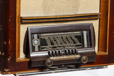 An old retro-style radio from the 1950s isolated on white background.