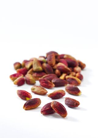 Pistachios on a white background seen from above