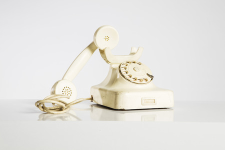 old fashioned rotary phone: Old telephone isolated on white