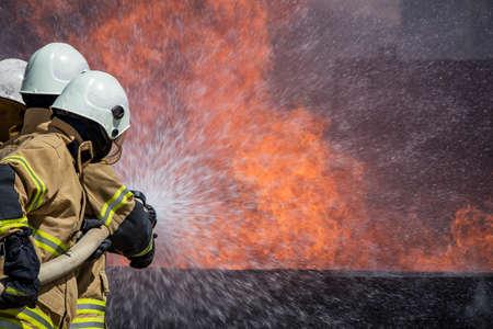 extinguishing: Firefighters Extinguishing House Fire