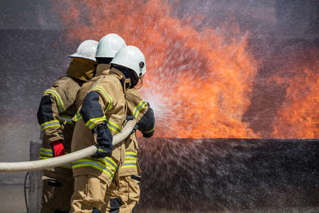 insurance themes: Firefighters Extinguishing House Fire