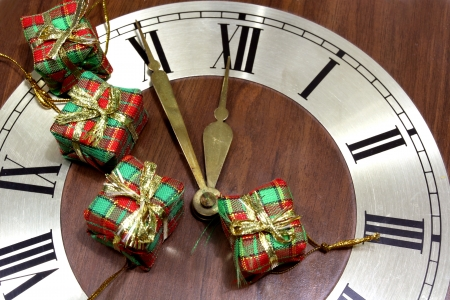 Old clock with four gifts photo