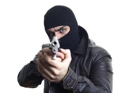Thief in balaclava Фото со стока