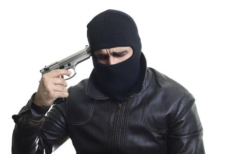 A thief in balaclava pointing his gun to his head...